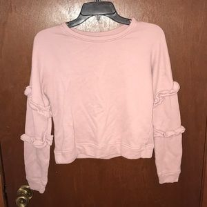 Long sleeved shirt with side ruffles